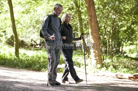 a mature couple walking in the