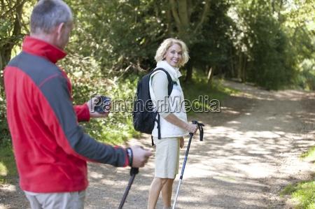 a mature couple walking along a