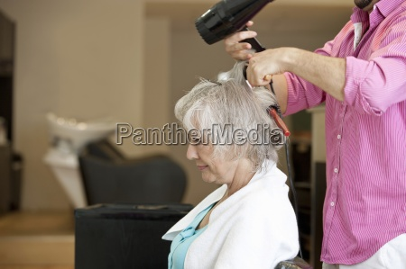 a senior woman having her blow