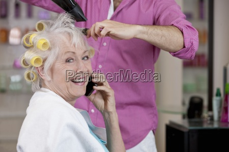 a senior woman talking on a