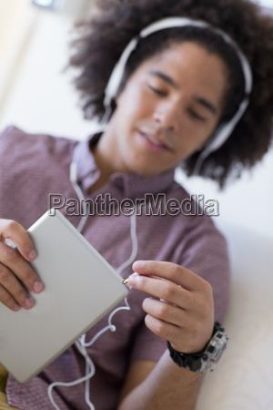 close up of young man plugging