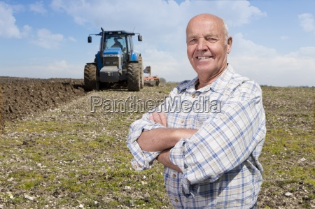 farmer standing with arms crossed in