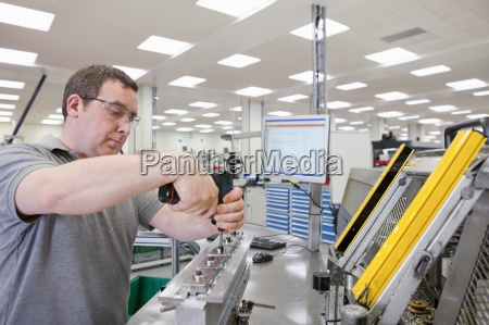 technician assembling product in hi tech