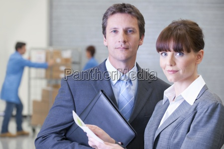 portrait of confident businessman and businesswoman
