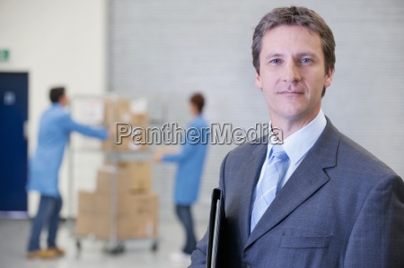 portrait of smiling businessman in warehouse