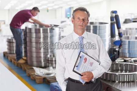 portrait of serious manager with clipboard