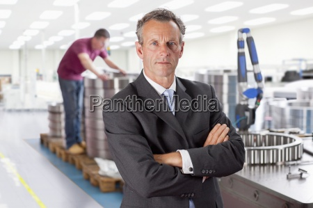 portrait of serious manager with arms