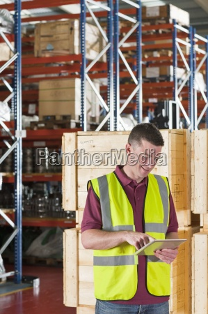 smiling worker in reflector vest using