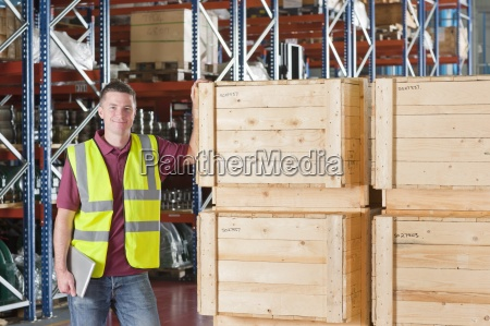 portrait of smiling worker in reflector