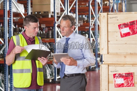 businessman and worker with digital tablet