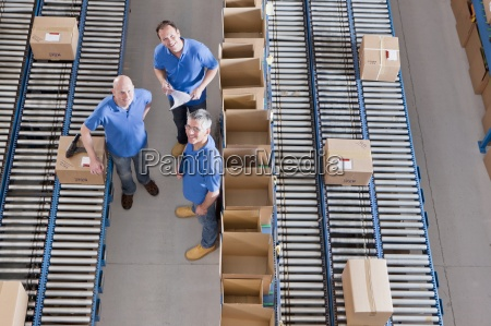 portrait of smiling workers among boxes