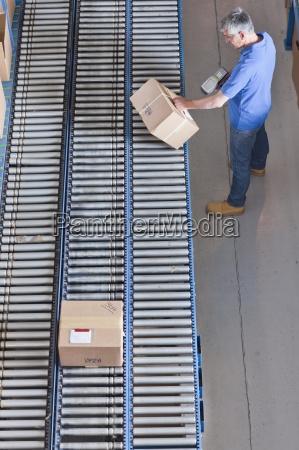worker with bar code reader scanning
