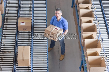 portrait of smiling worker holding bar