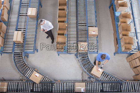 workers packing boxes on conveyor belts