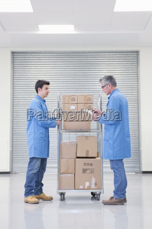 workers, with, cart, of, cardboard, boxes - 12917530