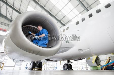 engineer testing engine of passenger jet