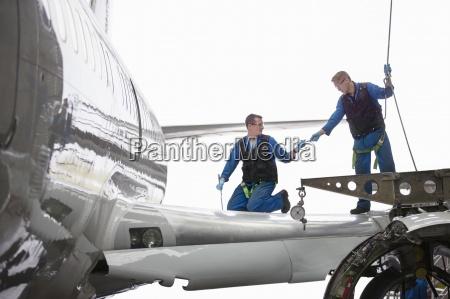 engineers repairing wing and landing gear