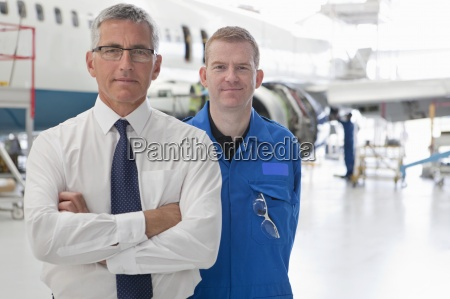 portrait of confident businessman and engineer