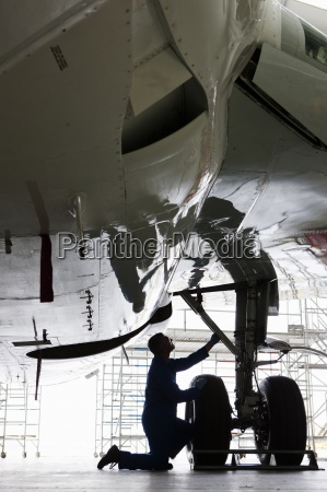 engineer inspecting landing on gear on