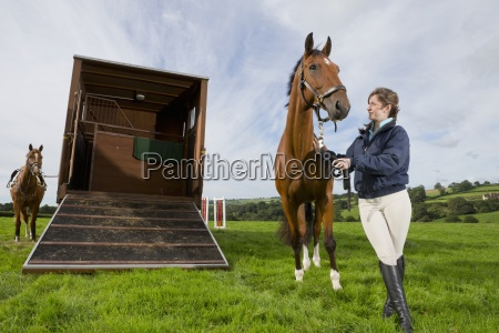 girl with horse next to ramp