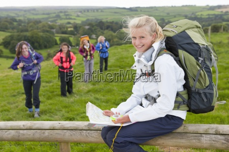 portrait of smiling girl with backpack