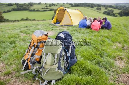 girls and backpacks in rural field