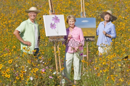 portrait of smiling seniors painting in
