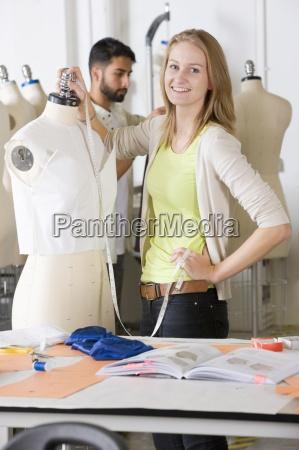 fashion design student working on garment