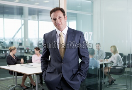 portrait of confident businessman standing with