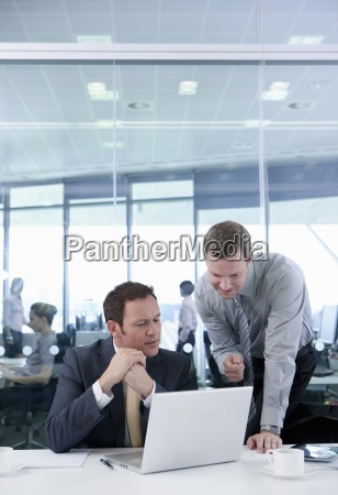 businessmen working at laptop in conference