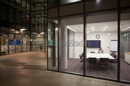 businesswoman working late in conference room