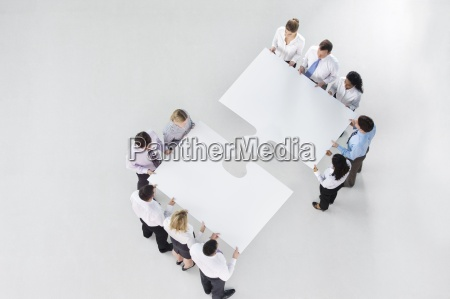 two groups of business people connecting