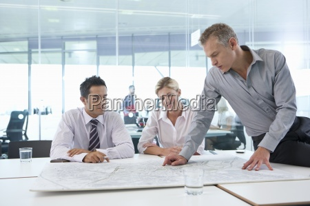 business, people, reviewing, map, in, conference - 12921128