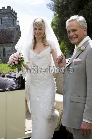 father helping bride out of vintage