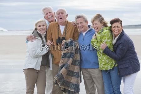 group of mature friends walking along
