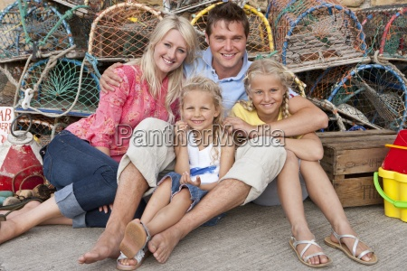 portrait of smiling family leaning against