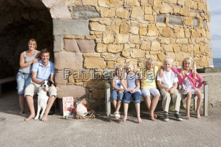 portrait of family with dog sitting