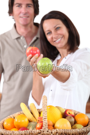 woman stood in front of fruit