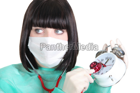 nurse listening the clock ticking with