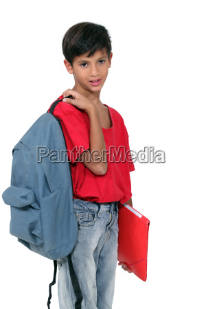 little schoolboy holding a backpack and