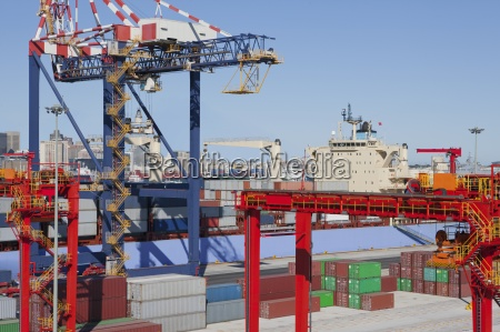 container ship moored at commercial dock