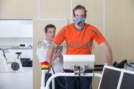 sports scientist with digital tablet monitoring