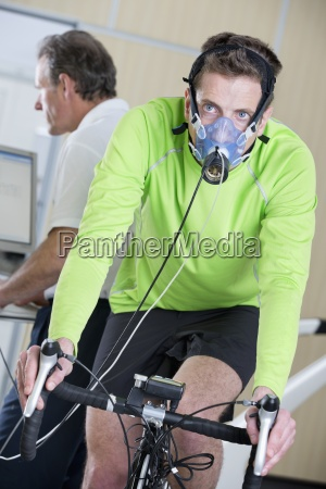 cyclist with mask on exercise bike