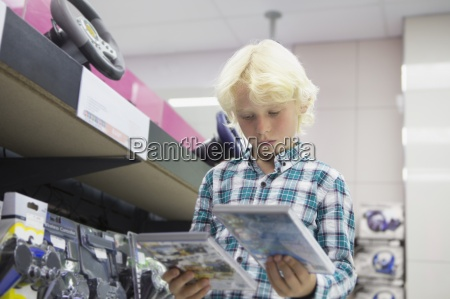 boy looking at video games in