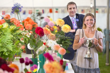 judge awarding trophy at flower show