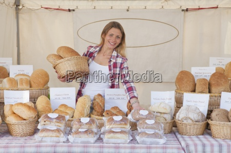 female baker on stall at country