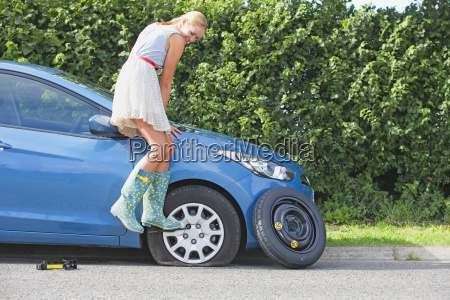 frustrated woman broken down with flat