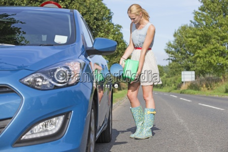 woman running out of fuel on