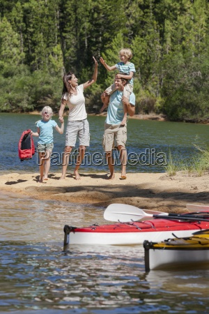 family high fiving at lakeside