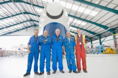 aircraft maintenance team with plane in